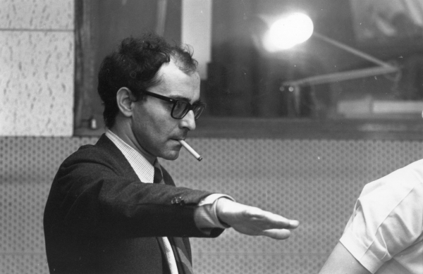 Jean-Luc-Godard-at-work-in-the-1960s-www.cinematheia.com_